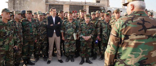 Assad_and_his_commanders-600x257