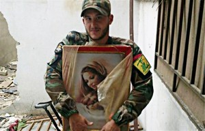 Hezbollah-fighter-with-an-image-of-the-Holy-Theotokos-300x192